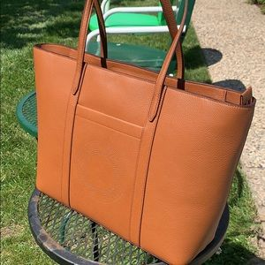 Cole Haan brown leather zip top tote.